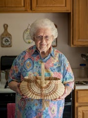 Artist Leona Waddell with one of her white oak baskets.