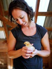 On the farm in Hendersonville, Meredith Leigh, whose focus with the non-profit is on education and outreach, administers medicine to sheep and feeds the pigs and chickens. Off the farm, she travels to do demonstrations on butchery, give talks to farmers on production and teaches charcuterie like sausage making.
