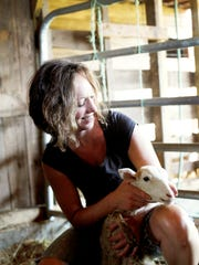 Meredith Leigh, an author, butcher, farmer and cook and has teamed up with Living Web Farms as the first female farm staff.