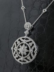 3.01 carat total weight diamond necklace and vintage pendant; 18K white gold. $10,245 from Diamond Vault Reno.