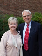 McClung Museum members Sharon and Bill Laing pose outside the museum at opening of the exhibition.