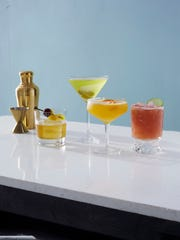 (Left to right) Maple Manhattan, Tomolive Martini,