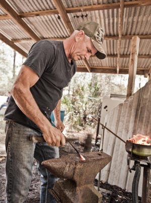 Rodney Richards forges oyster tongs in his shop in Apalachicola.
