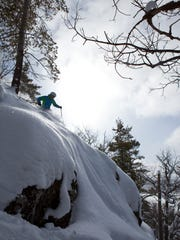 J.T. Robinson skis through powder at Mt. Bohemia in