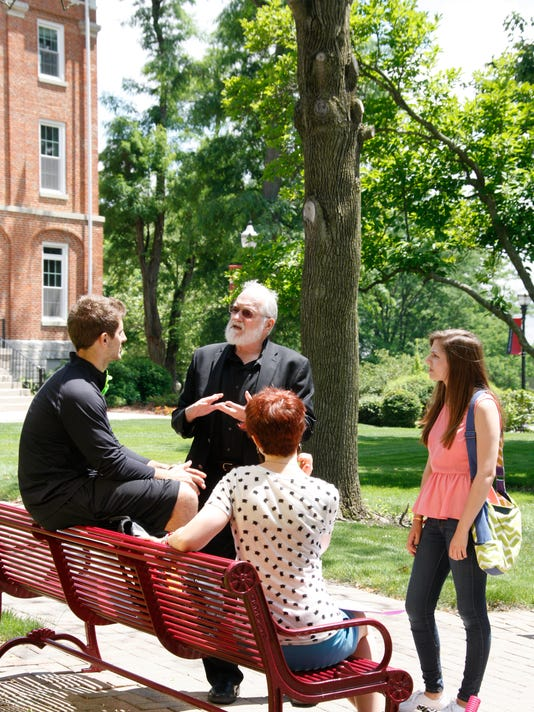 636251921181969035-Photo-of-Chaplain-Powers-with-students.jpg