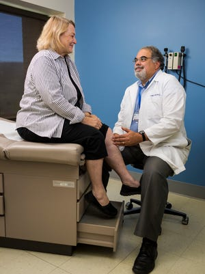 Dr. Joseph Mannino and oath patient, Kitty Shallenberger in the clinic room.