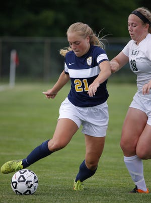 DeWitt's Mackenzie Dawes, left, is the top assists leaders in the Lansing area so far this season.