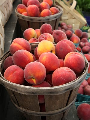 Baskets of Georgia peaches, shown at a roadside market in Pennsylvania in 2013. The 2017 crop is expected to be only 20% of its usual size.