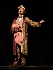 """Nicholas Yaquinto plays the part of Dr. Pangloss in the Florida State Opera's production of """"Candide."""""""