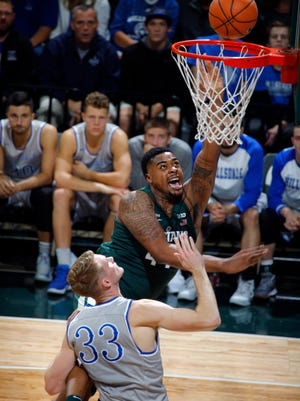 Nick Ward shoots over Hillsdale's Gordon Behr during the first half of Friday night's MSU exhibition game.