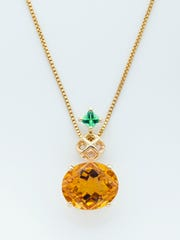 A mesh diamond pendant with fancy citrine and tsavorite
