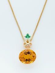 A mesh diamond pendant with fancy citrine and tsavorite