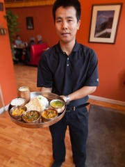 Sherpa Kitchen co-owner, Lakpa T. Lama serves up the Non Veg Thali dish at Sherpa Kitchen in Burlington.