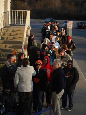 """Shoppers wait in line before the doors opened at 5 p.m. at Toys """"R"""" Us in Kenwood on Thanksgiving Day 2013."""