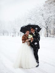 Megan and Fabian Puello are photographed after being married in Downtown Indianapolis on Jan. 5, 2014.