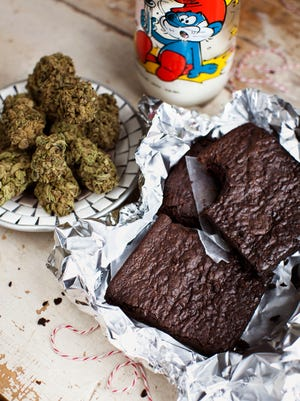 "This undated image provided by Elise McDonough via Chronicle Books shows brownies made from a recipe in the ""The Official High Times Cannabis Cookbook."" Cannabis cuisine is on the rise in the wake of legalizations around the country."