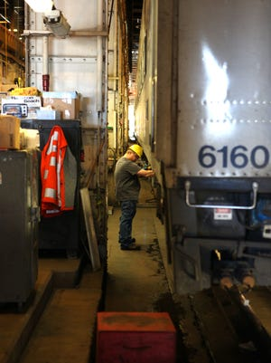 Mechanics work in the dark, crowded 105-year old Metro-North Maintenance Facility at the Croton-Harmon Yard, April 15, 2015.