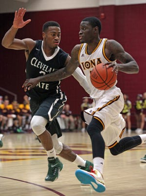 Cleveland State's  Trey Lewis guards Iona's A.J. English as he brings the ball upcourt during Friday night's game in New Rochelle.