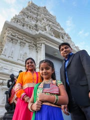 Palash Gupta, president of the Delaware Asian American Business Association, with his wife Payal and daughter Mishty in front of the Hindu Temple of Delaware in Hockessin.