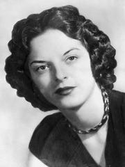 """FILE - In this 1955 file photo, Carolyn Bryant poses for a photo. A Justice Department report to Congress says the agency is reinvestigating the 1955 slaying of Emmett Till, a black teenager whose brutal killing in Mississippi after receiving what it calls """"new information."""" The report doesn't say what any potential new evidence might be. But it follows the publication of a book which included passages where Donham, then known as Carolyn Bryant and a potential witness at the time, acknowledged lying. (AP Photo/Gene Herrick, File)"""