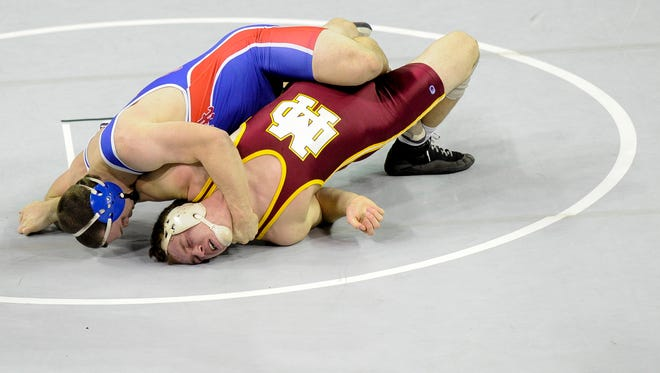 Mater Dei's Kurtis Wilderman, bottom, and South Putnam's Kyle Shaffer, compete in their 195-pound semifinal match  during the Reitz wrestling semistate at the Ford Center, Saturday, Feb. 11, 2017.