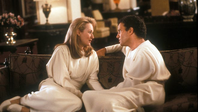 """Meryl Streep and Albert Brooks play souls who meet in a way station between lives in ?Defending Your Life.? Meryl Streep and Albert Brooks are souls who meet in a way station between lives in 1991's """"Defending Your Life."""""""