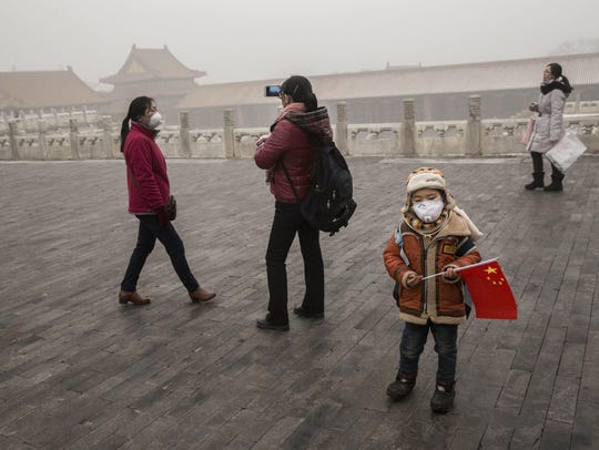 A Chinese boy wears a mask as protection from pollution