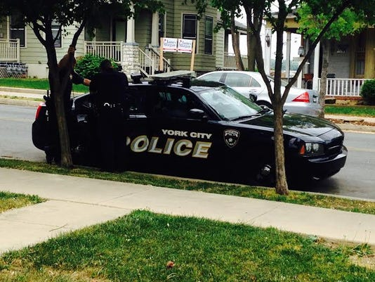 York City Police talk with man they arrested Wednesday afternoon after witnesses say he fired a shot inside a home.