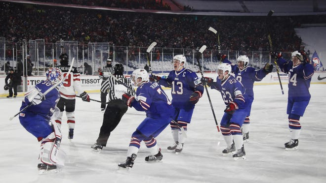 Players for the United States celebrate following their shootout period of a preliminary round game against Canada in the IIHF world junior championship in Orchard Park, N.Y., Friday, Dec. 29, 2017. U.S. won, 4-3, in overtime shootout. (Mark Blinch/The Canadian Press via AP)