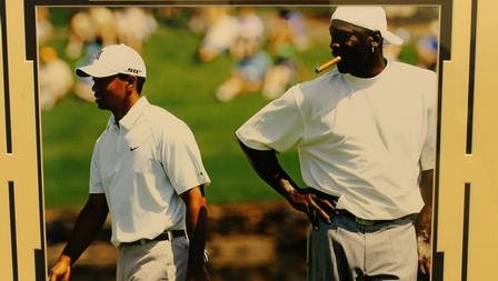 An autographed photo of Tiger Woods playing golf with Michael Jordan is among the items up for bid in the Delaware Small Business Chamber's annual scholarship auction.
