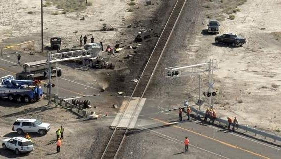 The wreckage of the tractor-trailer is seen in the lower right while the train it hit is farther in the distance near Trinity between Lovelock and Fernley on June 24, 2011.
