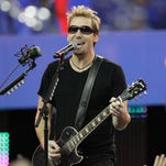 Nickelback canceling its summer tour as lead singer Chad Kroger has been diagnosed with an operable cyst on his voice box. The band in November 2011.