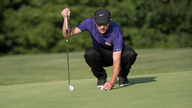 Unioto's Max Rose stares down a putt during an earlier season conference match at Dogwood Hills Golf Course. Rose and the Shermans will compete in Sunbury this weekend in the Division II OHSAA State Golf Tournament.