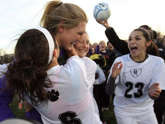 Bridgewater-Raritan teammates mob Casey Murphy after she led the Panthers to a sectional title in 2013.