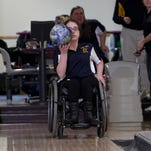 Caitlyn Wells, 16, says bowling is an activity that has helped instill a sense of belonging. Grand Ledge sophomore bowling team member Caitlin Wells between sets at Royal Scot in Lansing January 13, 2015. Wells has spinal bifida, and has been in a wheelchair her entire life.