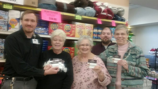 The Bull Shoals Harp's Food Store presented the Bull Shoals Pantry with a donation of $2,500 in gift cards to be used in purchasing food for the Pantry. Shown from left to right areHarp's manager Jacob Moss, Harp's manager Peni Lloyd, Food Pantry treasurerBonnie Galvan, Harp's grocery manager Josh Gunter and Food Pantry inventory manager Sharon Arra.