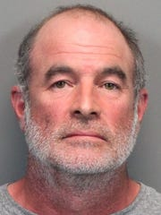 Mark Constantino, 53, in an August 2015 booking mugshot.