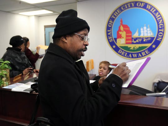 Charles Johnson, founder of H.A.R.P., a homeless agency, fills out a form on issues he would like to discuss with Mayor Dennis P. Williams on Wednesday.