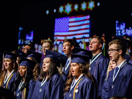 Senior choir members sing the national anthem during Brookfield East High School's 2018 commencement on Sunday, June 10. The Elmbrook School District has been ranked as the No. 1 school district in the state by Niche.