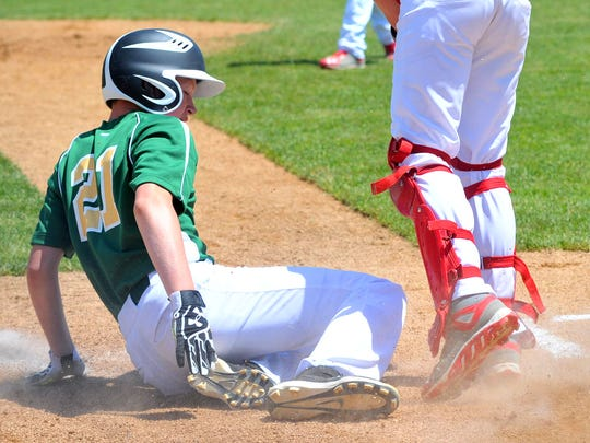 Edgar's Kyle Brewster slides in home during Saturday's Small Town Baseball state championships at Jack Hackmann Field in the Steve J Miller Recreation Area in Marshfield.