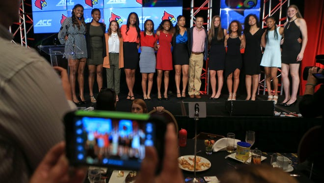 UofL women's basketball team posed for photos after Wednesday's basketball luncheon at the Downtown Marriott. Oct. 14, 2015