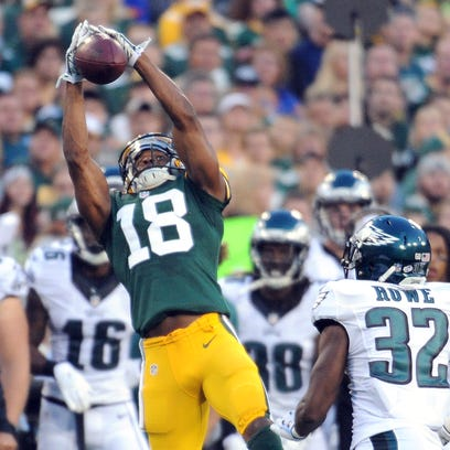 Green Bay Packers receiver Randall Cobb (18) jumps