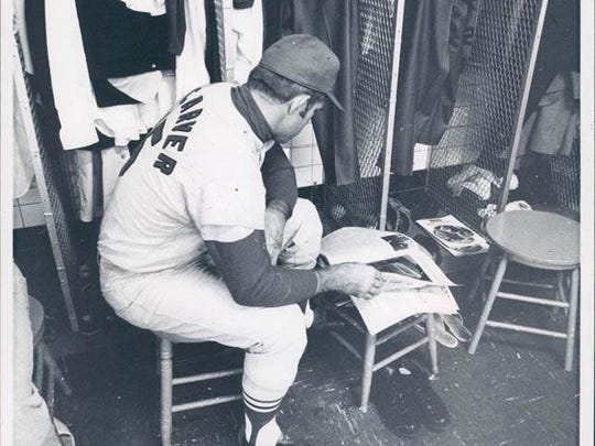 Cardinals' Tim McCarver in Tiger Stadium Locker Room during the 1968 World Series waiting for the game to resume.