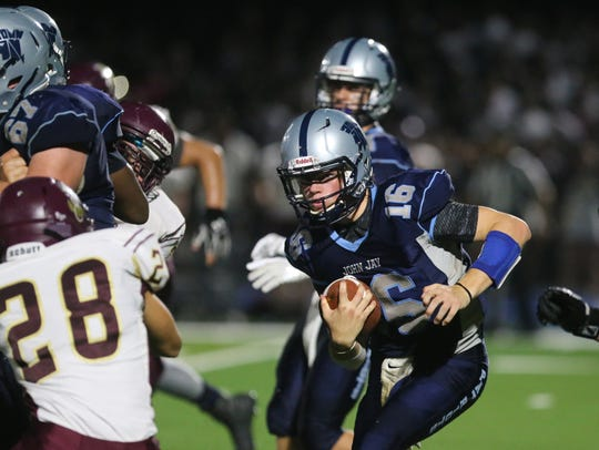 John Jay High School quarterback Richie Eletto evades
