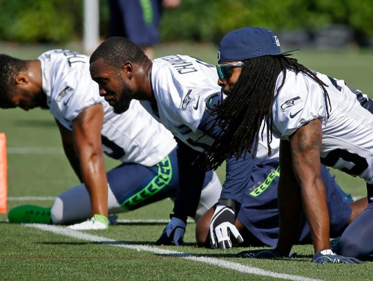 Seattle Seahawks cornerback Richard Sherman, right,
