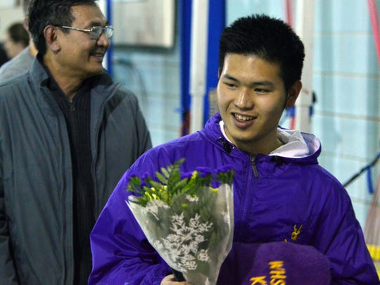 Khai Vin accepts flowers and a Waynesboro swim team towel during the senior day announcement at the Waynesboro YMCA on Wednesday, January 20. Vin swam with the team for only his senior year, but said if he could go back in time and join his freshman year he would.