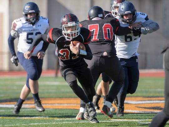 Newark Valley sophomore Caden Bennett runs through