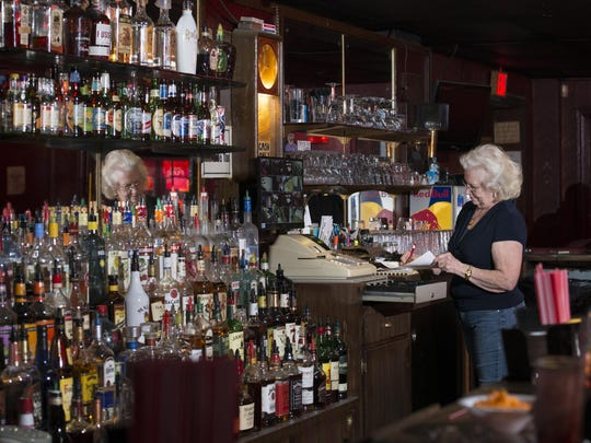 Longtime bartender Melba Murphy, 80, does some paperwork at the Azalea - the iconic, oldest operating liquor bar - in Pensacola on Wednesday, March 15, 2017.