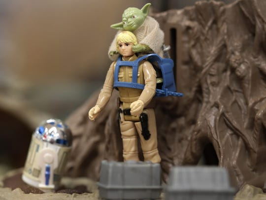 """Figures of R2-D2, Luke Skywalker and Yoda populate a 1981 Dagobah playset. The action figures are part of a """"Star Wars"""" exhibit at the Gerard H. Van Hoof Library in Little Chute. It contains hundreds of toys made by Kenner Products in the 1970s and '80s."""