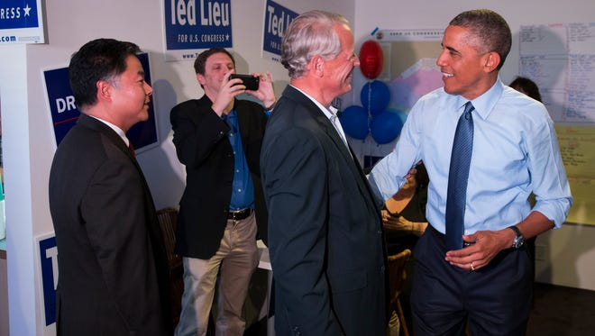 President Barack Obama, right, talks with Rep. Steve Israel, D-N.Y., during a visit to the campaign office State Senator Ted Lieu, left, who is running for Congress, on Thursday, Oct. 9, 2014, in Los Angeles. Obama is traveling in Los Angeles for an overnight trip during which he will discuss the nation's economy and designate a swath of Southern California mountains as a national monument. (AP Photo/Evan Vucci)   ORG XMIT: CAEV119